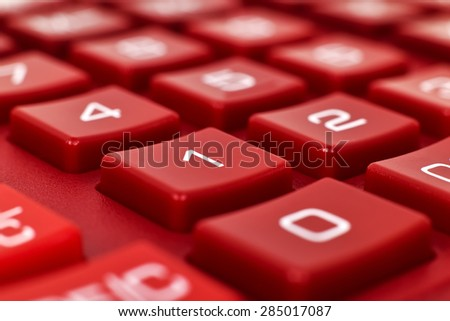 number on red calculator, extra close up - stock photo