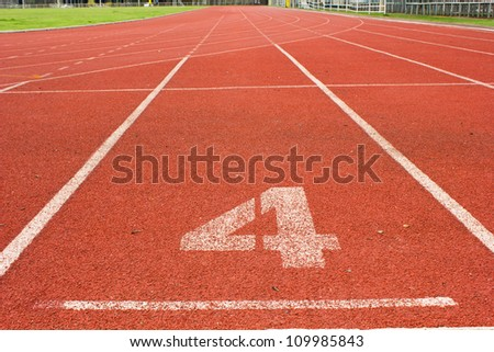 number 4 on red running track - stock photo