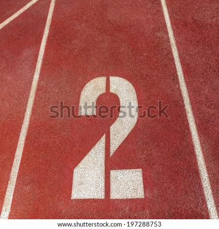number 2 on red running track  - stock photo