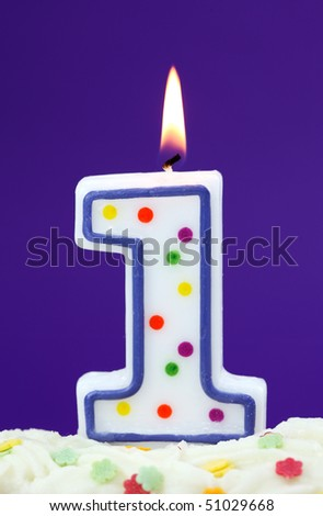 Number one birthday candle on lilac background - stock photo