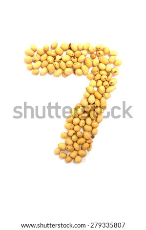 Number seven made by sweets beans with colored sugar coat - stock photo
