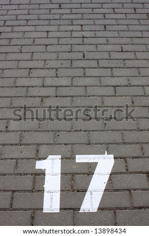number seventeen on concrete pavement - stock photo