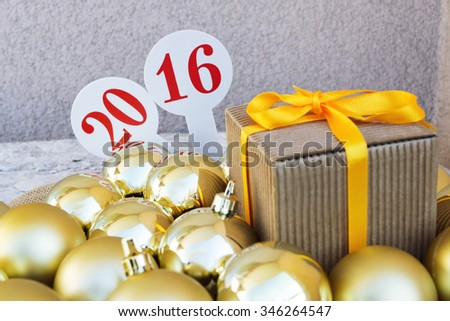 Number 2016 surrounded Christmas balls ball ornament decoration, new year gretting card - stock photo