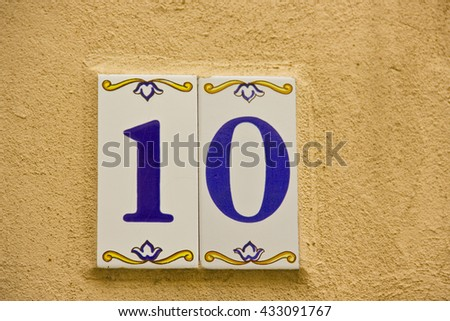 Number ten in a ceramic tile on street - stock photo