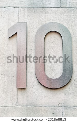 Number ten on a wall - stock photo