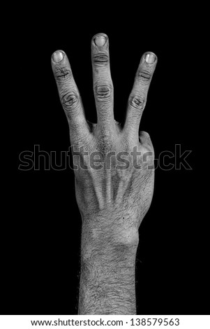 number three composed by a grunge hand isolated on black background - stock photo