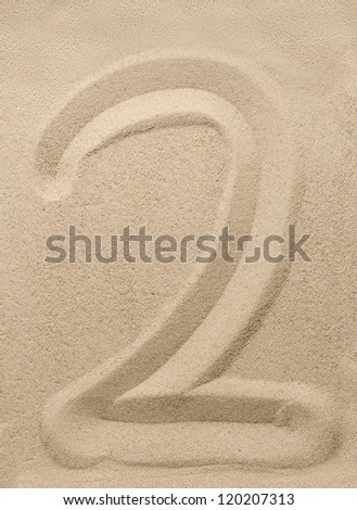 Number two writing on the sand - stock photo