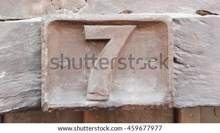 number 7 woodcarving form old town - stock photo