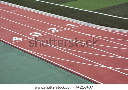 numbered running track for athletes - stock photo