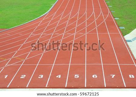 Numbered Running Tracks Of A Stadium - stock photo