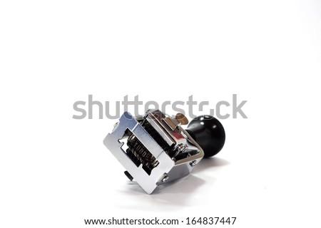 Numbering machine on white background - stock photo