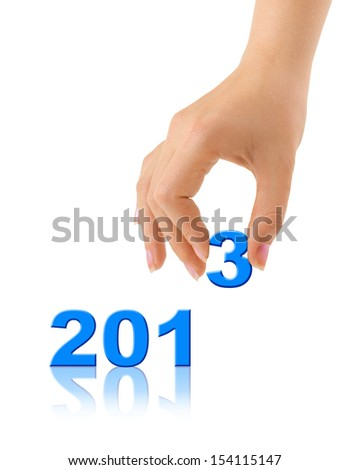 Numbers 2013 and hand isolated on white background - stock photo
