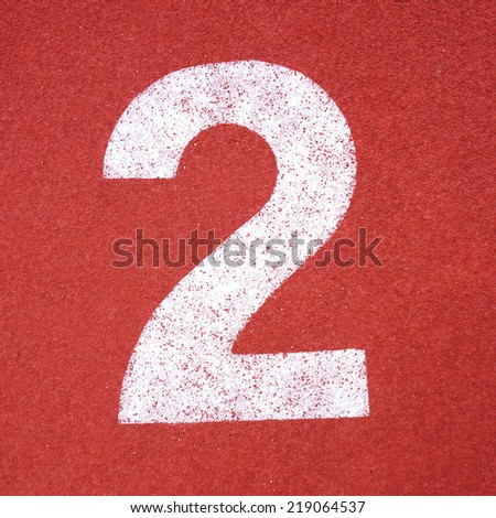 Numbers nine on red running track - stock photo