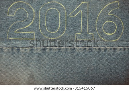 Numbers 2016 of chalk contour on the background of the jeans. Christmas theme. Toned. - stock photo