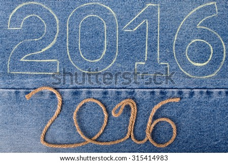 Numbers 2016 of rope and chalk contour on the background of the jeans. Christmas theme. - stock photo