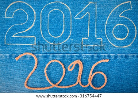 Numbers 2016 of rope and chalk contour on the background of the jeans. Christmas theme. Toned. - stock photo