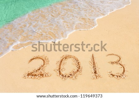 Numbers 2013 on beach - concept holiday background - stock photo