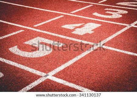 Numbers on rubber  running track standard red color. - stock photo