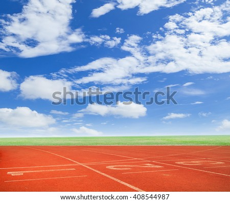 Numbers on running track with blue sky background - stock photo