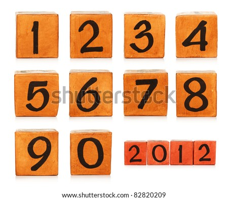 numbers on wooden painted cubes - stock photo