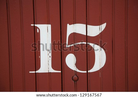 Numbers painted on the sides of old railway boxcars from the early to mid 1900's. - stock photo