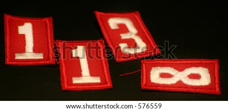 Numbers (Red Scout Patches) - stock photo