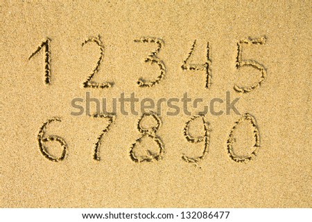 Numbers written on a sandy beach. (from one to ten) - stock photo