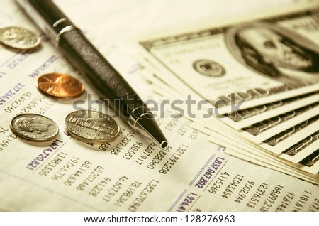 Numeral statement, pen and US currency - stock photo