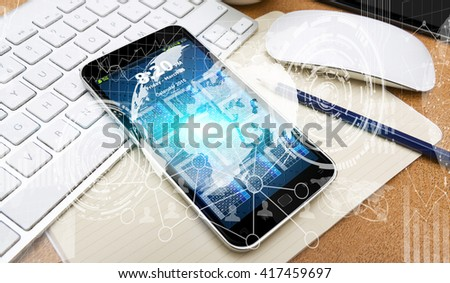 Numerous charts, screens and graphics over mobile phone in office - stock photo