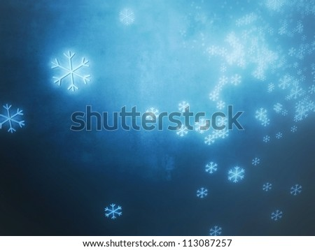 Numerous falling snowflakes on a blue and dark background, referring to concepts such as winter, seasonal weather, snow, as well as Christmas - stock photo