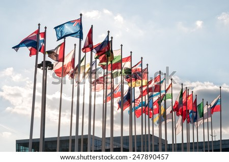 Numerous flags of states on cloudy sky background. Moscow, Russia. - stock photo