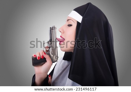 Nun with gun isolated on the white - stock photo