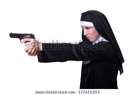 Nun with handgun isolated on white - stock photo