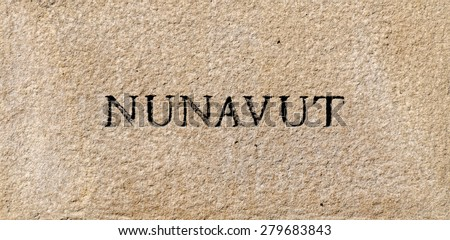 Nunavut province sign engraved in a rock plate - stock photo