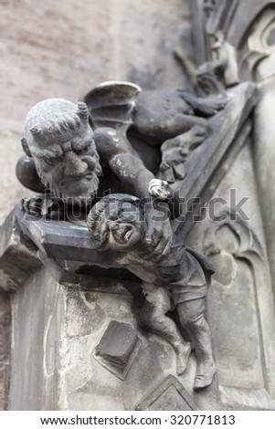 NUREMBERG, GERMANY -  SEPTEMBER 04, 2015: Photo of Sculpture heck takes away liar. - stock photo