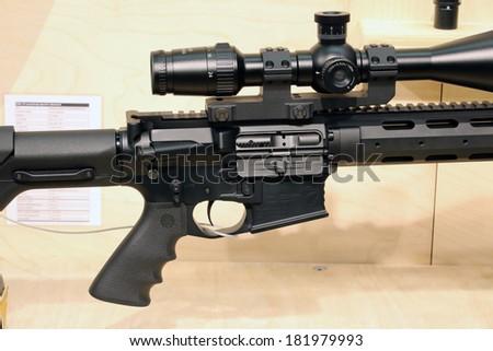 NURNBERG, GERMANY - MARCH 9: DAR-15 Long Range Sporter Advanced carbine on display at IWA 2014 & Outdoor Classics exhibition on March 9, 2014 in Nurnberg, Germany - stock photo