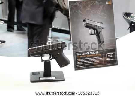 NURNBERG, GERMANY - MARCH 9: Glock 42 subcompact handgun on display at IWA 2014 & Outdoor Classics exhibition on March 9, 2014 in Nurnberg, Germany - stock photo