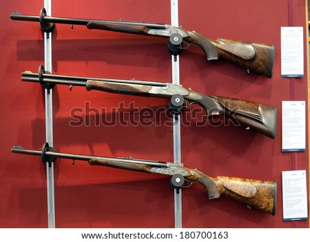 NURNBERG, GERMANY - MARCH 9: Krieghoff shotguns on display at IWA 2014 & Outdoor Classics exhibition on March 9, 2014 in Nurnberg, Germany - stock photo