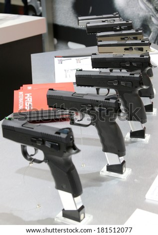 NURNBERG, GERMANY - MARCH 9: Kriss Sphinx pistols family on display at IWA 2014 & Outdoor Classics exhibition on March 9, 2014 in Nurnberg, Germany - stock photo