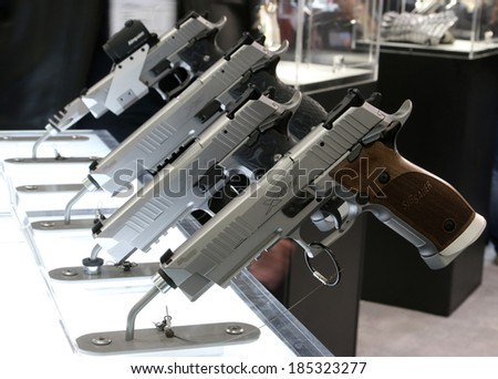 NURNBERG, GERMANY - MARCH 9: Sig Sauer X-Five family of handguns on display at IWA 2014 & Outdoor Classics exhibition on March 9, 2014 in Nurnberg, Germany - stock photo
