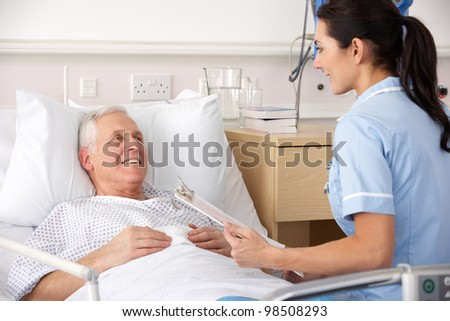 Nurse and male patient in UK Accident and Emergency - stock photo