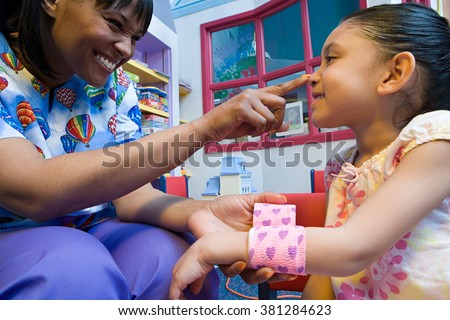 Nurse caring for girl - stock photo