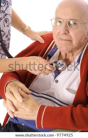 nurse checking elderly mans pulse vertical - stock photo