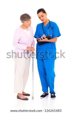 nurse explaining  medical test result to senior patient - stock photo