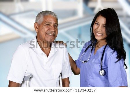 Nurse giving physical therapy to an elderly patient - stock photo