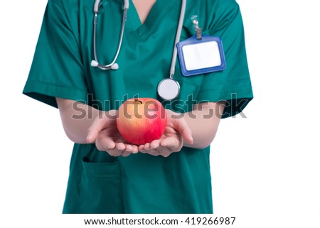 Nurse holding green apple. All on white background. - stock photo