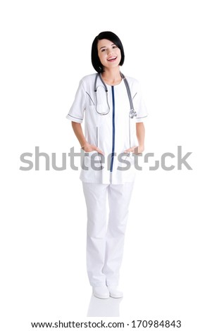 Nurse or young doctor standing smiling. Isolated on white background. Full body  - stock photo