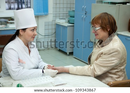 nurse pricked blood from  patient in clinic - stock photo
