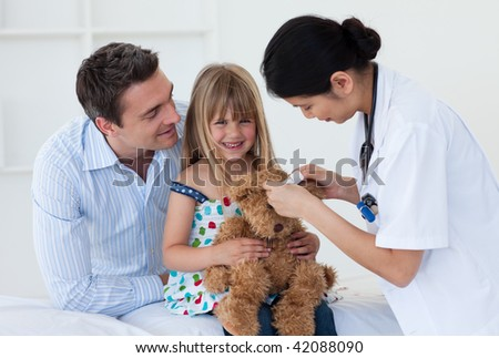 Nurse reviewing a little girl - stock photo