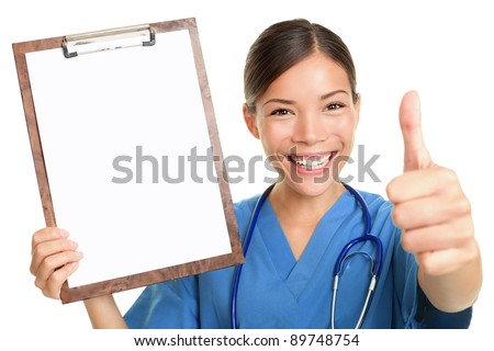 Nurse showing blank clipboard sign smiling happy giving thumbs up success sign wearing stethoscope and scrubs. Multicultural Asian Caucasian female nurse or young doctor isolated on white background. - stock photo